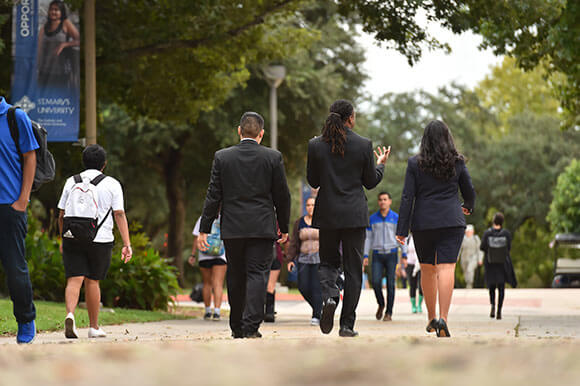 Students walking in business suits