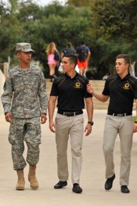 Three ROTC students walking on campus