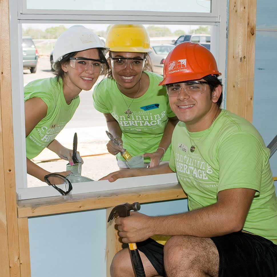 St. Mary's student volunteers work on a Habitat for Humanity house