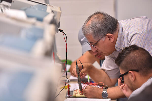Djaffer Ibaroudene, Ph.D., instructs Electrical Engineering students.