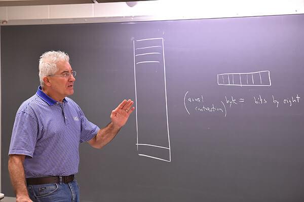 Arthur Hanna, Ph.D., teaches a Computer Science course.