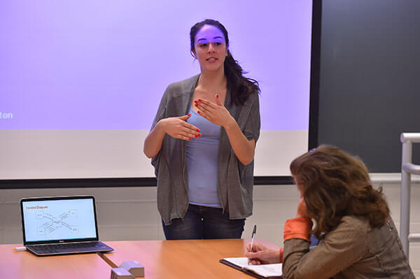 A Computer Information Systems student gives a presentation to her classmates.
