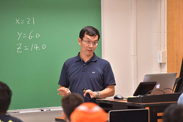 Wenbin Luo, Ph.D., lectures in class.
