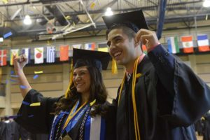 Two students at commencement