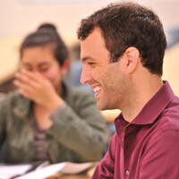 Two students smile in an International Global Studies class