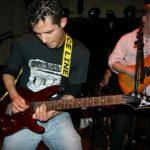 Jason Torres playing his guitar