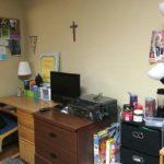 Student desks in Lourdes Hall