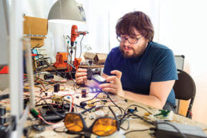 Matteo Borri working at a workbench full of electrical tools