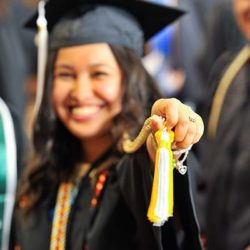 A McNair student at commencement