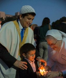 Participants light their candles during the IPP event at the Bell Tower