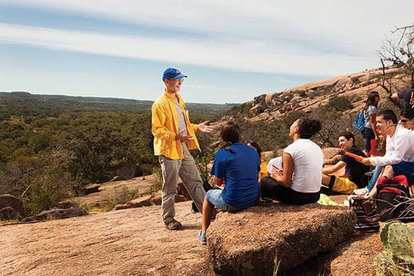 David Turner, Ph.D., talks to Environment Science students at Enchanted Rock.