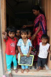 Children in the Marianist schools in Bangalore's slums say goodbye to visiting St. Mary's students.