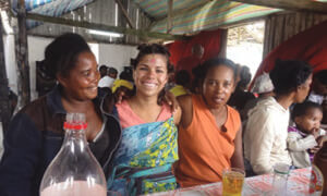 Samantha Bezdek (B.A. '10) posing with villagers in the Madagascar town she lives in