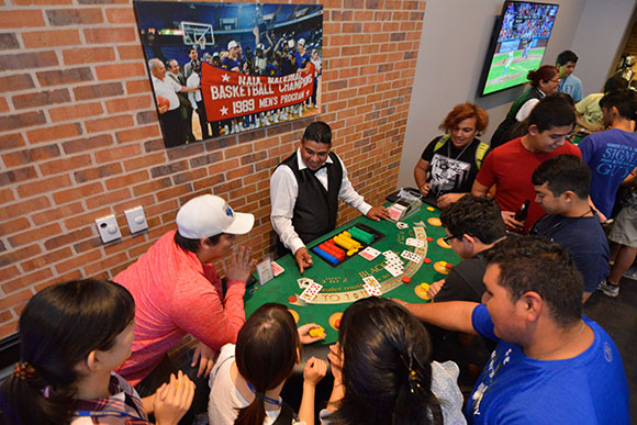 Students play poker at Casino Night at The Pub at St. Mary's.