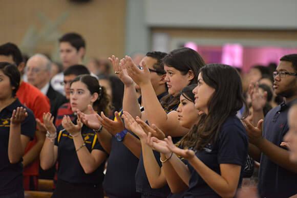 Students praying at Opening School Mass.