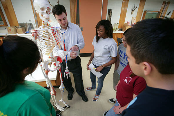 Ted Macrini, Ph.D., Associate Professor of Biology, teaches students about the human body.