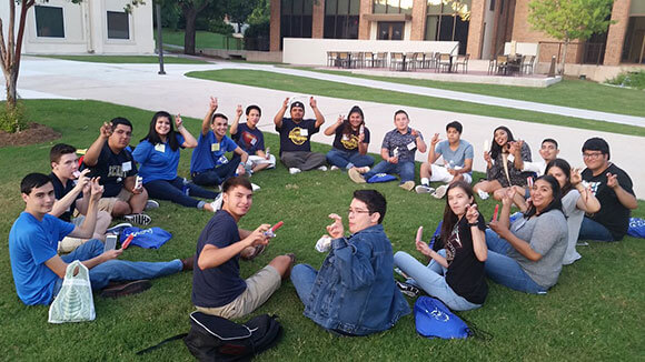 Students eat paletas and do the fangs out sign at the Zaragoza Paleta Social.