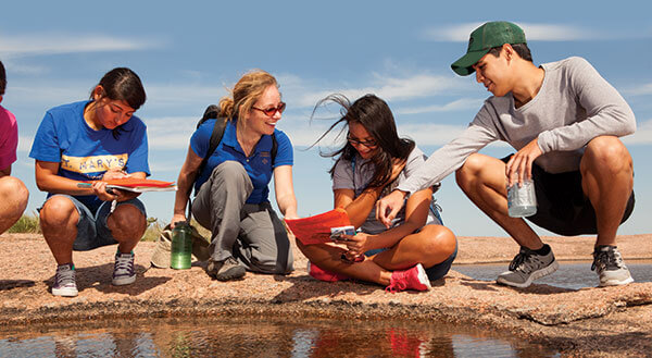 Evelynn Mitchell, Ph.D., instructs students at Enchanted Rock.