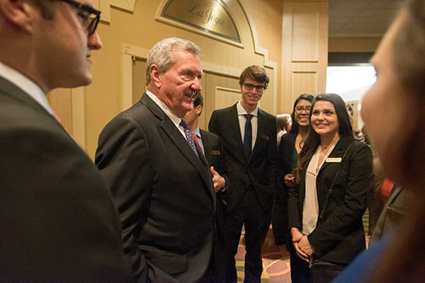 Bill Greehey speaks with Greehey Scholars at the 2016 Business Week awards dinner.