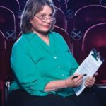 Patricia Owen, Ph.D., poses in a San Antonio movie theater.