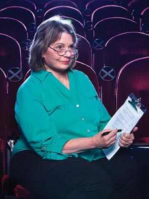 Patricia Owen, Ph.D., poses in a San Antonio movie theater.