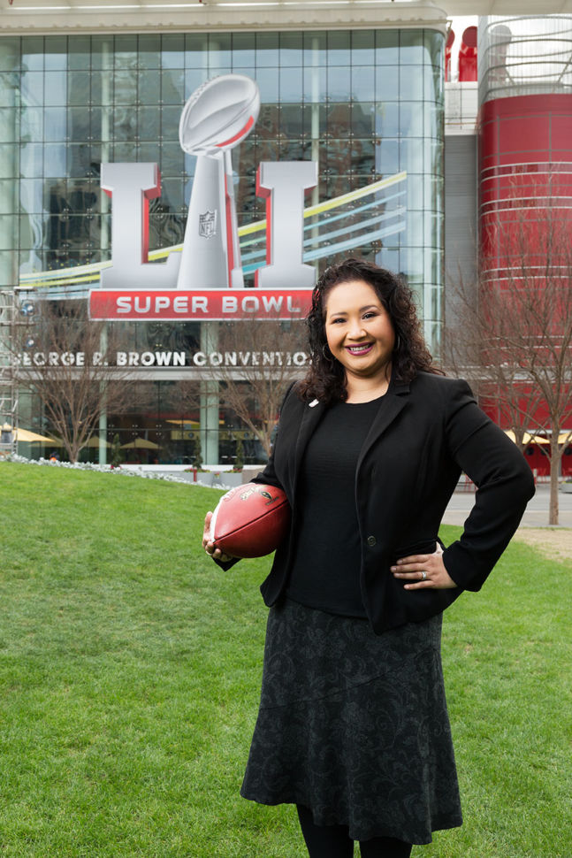 Erica Baum in front of the Houston stadium