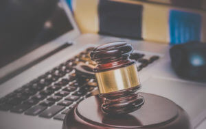 Photo of gavel and computer