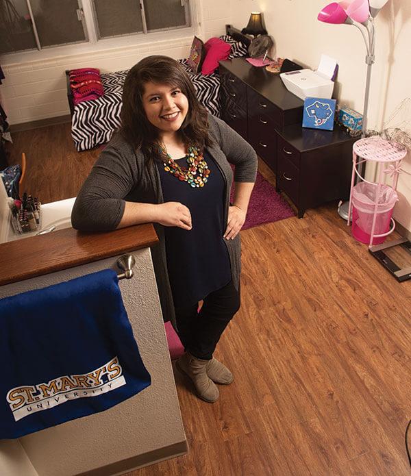 Paige Gandara-Valderas poses inside her room in Chaminade.