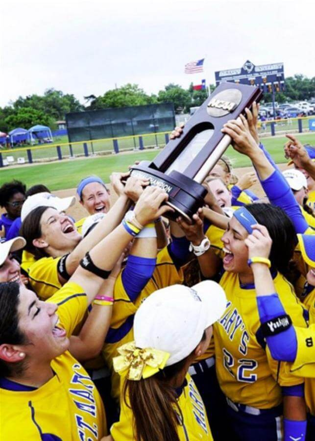 The Rattler softball team holds their NCAA Division II trophy high in celebration