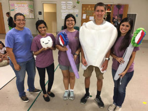 Pre-dental senior Millie Garcia stands center with students.