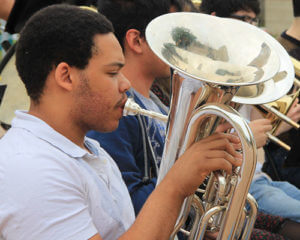 Male student plays a baritone in an ensemble