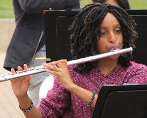 A student plays the flute in the wind ensemble