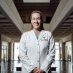 Dr. Kelly Morales (B.S. '99) stands in her clinic.
