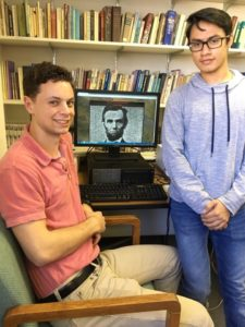 St. Mary's University students display their art project that compiles 1,000 faces of St. Mary's students into a portrait of President Abraham Lincoln