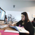 Photo of student studying her language book in the Languages computer lab.