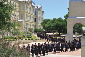 St. Mary's commencement procession winds past historic Reinbolt Hall.