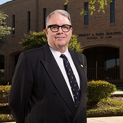 Dean Sheppard stands in front of Raba Building.
