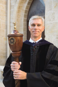 Assistant Dean Mike Barry holds the mace at a law school event.