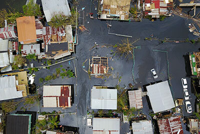 Floodwaters overwhelm the neighborhood of Juana Matos in Cataño, Puerto Rico, after Hurricane Maria inundated the island in September.