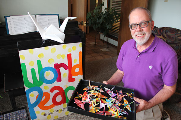 Brother Brian Zampier with his origami cranes.