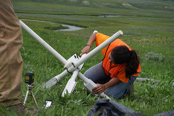 Rebeca Gurrola sets up equipment at Yellowstone National Park.