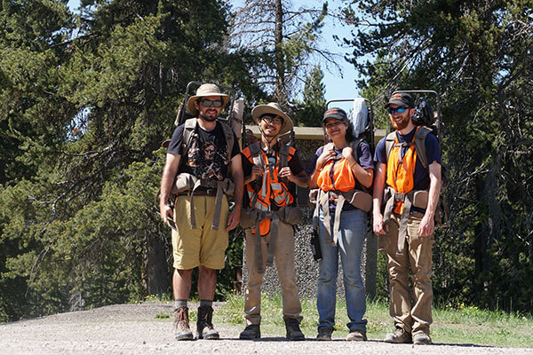 Student Rebeca Gurrola stands with research group at Yellowstone.
