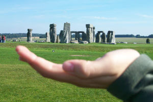 "Hand appearing to ""hold"" Stonehenge"