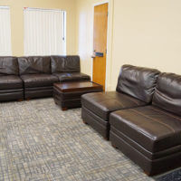 Plush seating in a Donohoo Hall common lounge