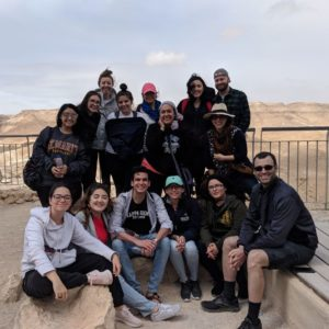The group poses in Israel