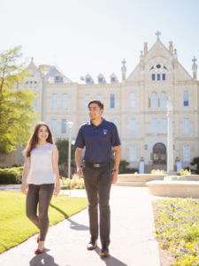 St. Mary's University students take a stroll in front of St. Louis Hall in San Antonio, Texas.